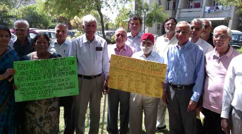 Senior citizens in a group housing society of Dwarka urge the government to save them from dust and noise pollution of extended construction activity. Photo by Rakesh Raman