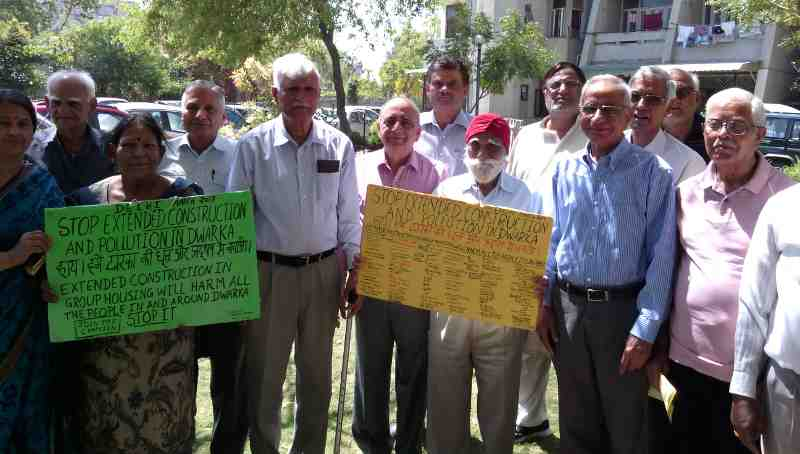 Senior citizens in a group housing society of Dwarka urge the government to save them from dust and noise pollution of extended construction activity. Campaign and Photo by Rakesh Raman