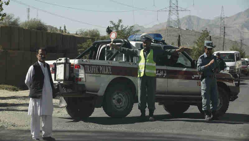 An Afghan traffic policeman controls a traffic jam in Maidan Shar. Photo UNAMA / Fardin Waezi.