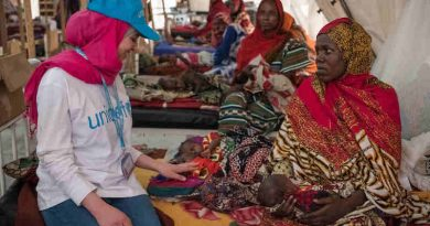 (left) Syrian refugee and education activist Muzoon Almellehan speaks with Salmata, 21, from Tala village as she sits on a bed alongside her three-week-old malnourished triplets at the nutrition ward in Bol Regional Hospital, Lake Region, Chad, Tuesday 18 April 2017.