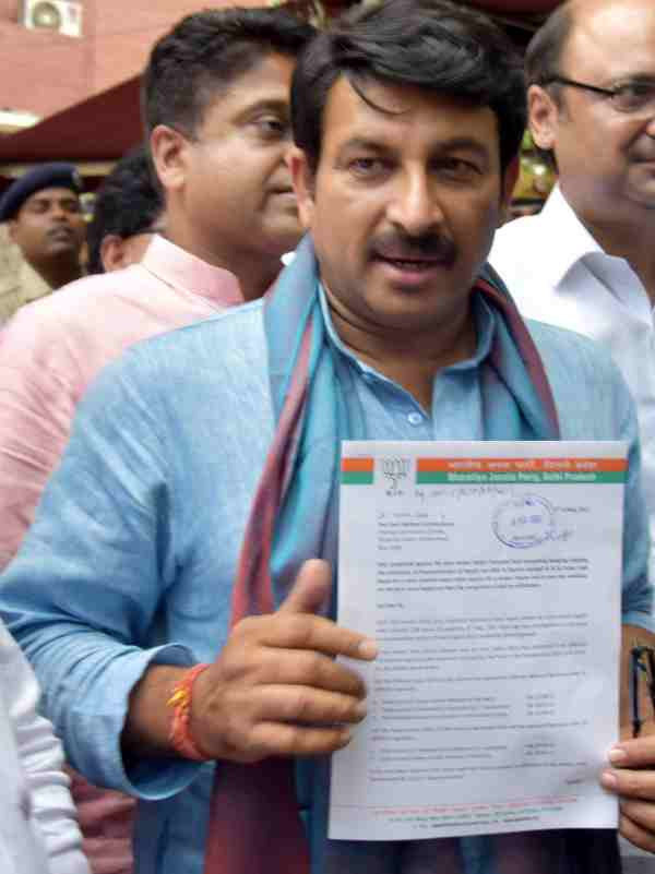 BJP leader showing complaint letter regarding irregularities in the donation records of AAP.