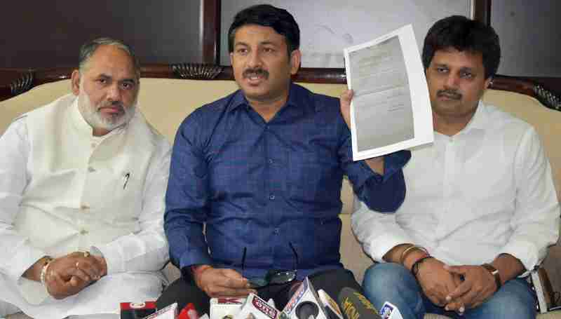 Delhi BJP President Manoj Tiwari presented copy of a complaint filed by a PWD engineer.