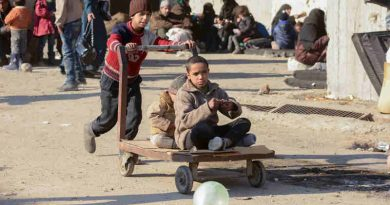 Children at a shelter in Jibreen, Aleppo, Syria, play with a cart. Photo: UNICEF/Rzehak