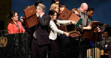 Conference officers hold up empty ballot boxes before collecting ballots from delegates. UN Photo/Manuel Elias