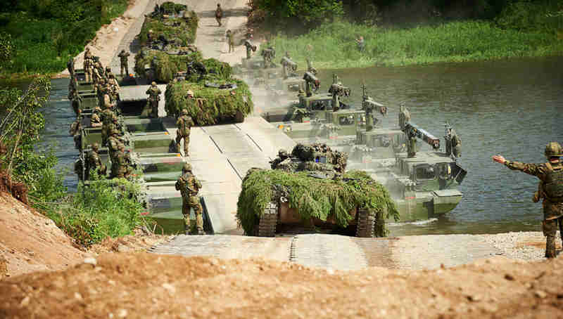 NATO Secretary General Jens Stoltenberg watched two of NATO's battlegroups train in Lithuania.
