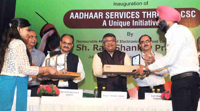 "The Union Minister for Electronics & Information Technology and Law & Justice, Shri Ravi Shankar Prasad presenting the award for outstanding performance, at the inauguration of the workshop on ""Aadhaar Services - A Unique Initiative through CSC"", in New Delhi on July 11, 2017."