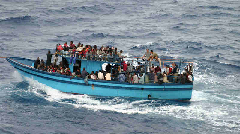 A boat carrying asylum seekers and migrants in the Mediterranean Sea. Photo: UNHCR/L.Boldrini