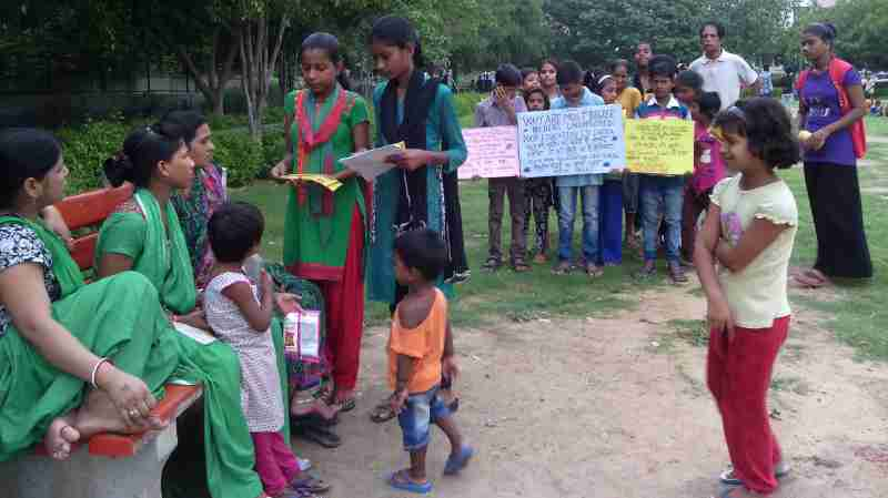 Students of RMN Foundation school explaining the benefits of modern alternative education to parents.