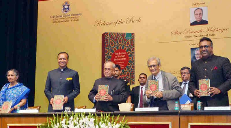 "Pranab Mukherjee receiving the first copy of the book ""The Future of Indian Universities: Comparative and International Perspectives"", at Rashtrapati Bhavan, in New Delhi on July 17, 2017"
