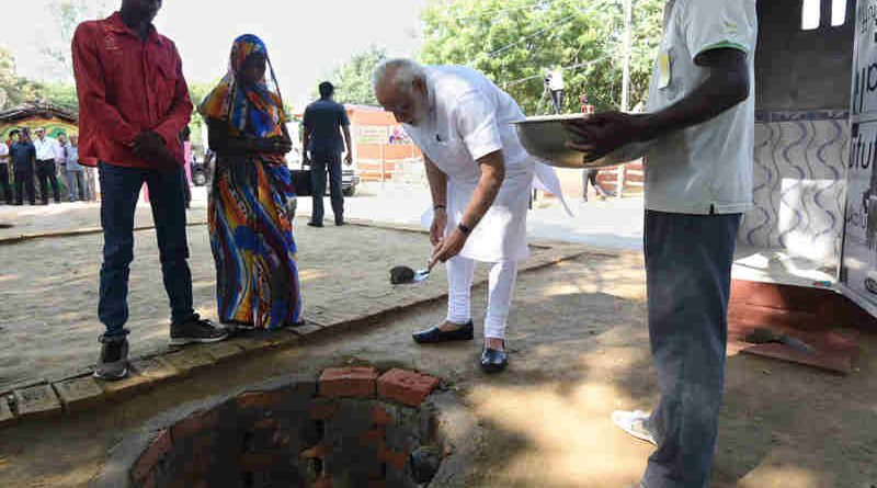 Narendra Modi doing shramdan for the construction of a twin pit toilet, at Village Shahanshahpur, Varanasi, Uttar Pradesh on September 23, 2017