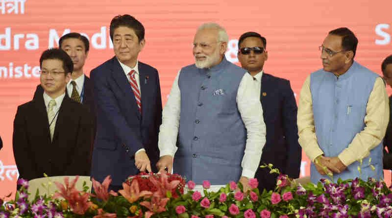 Narendra Modi and the Prime Minister of Japan, Mr. Shinzo Abe laying the foundation stone for Mumbai-Ahmedabad High speed Rail Project, at a function, at Ahmedabad, Gujarat on September 14, 2017. The Chief Minister of Gujarat, Shri Vijay Rupani is also seen.
