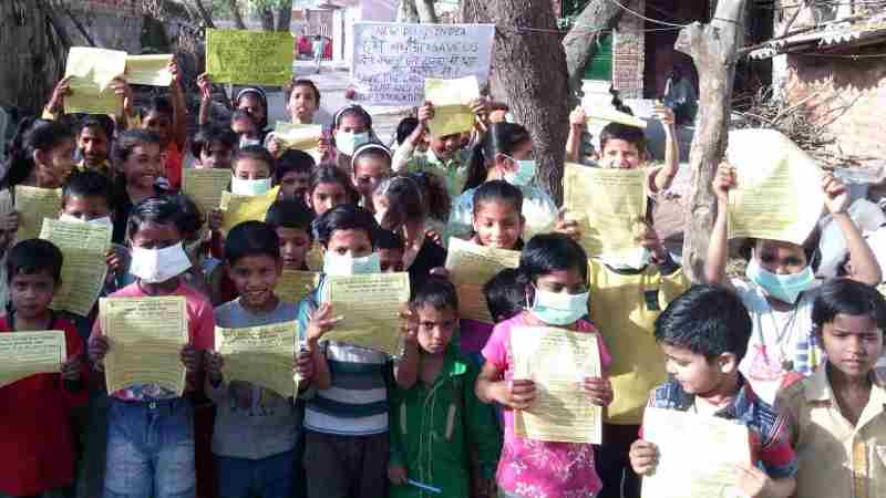 Children participating in RMN Foundation campaign to stop extended construction and pollution in Delhi.