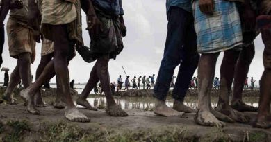 In September 2017, newly arrived Rohingya refugees from Myanmar walk through paddy fields and flooded land after they fled over the border into Cox's Bazar district, Chittagong Division in Bangladesh. Photo: UNICEF/Brown
