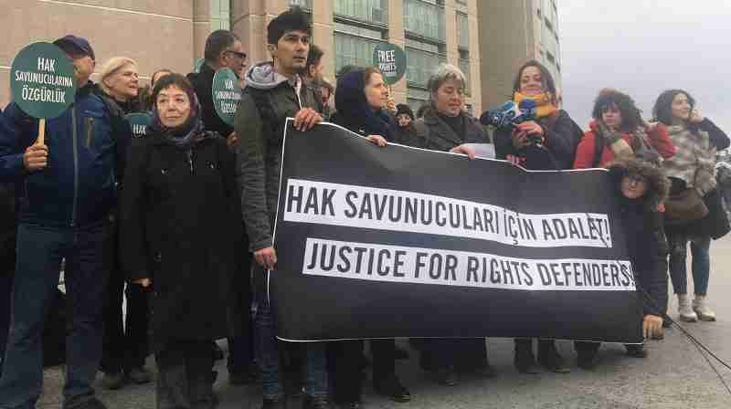 Delegation of human rights defenders outside court where trial of Taner continues. Photo: Amnesty International