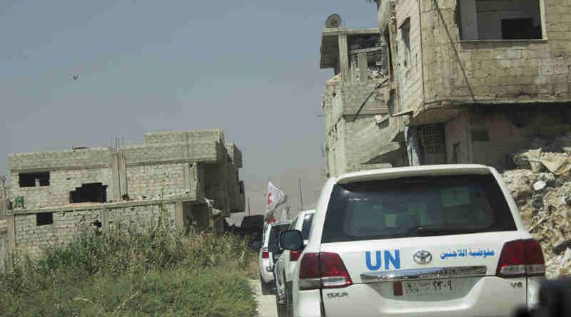 Inter-agency convoy to Duma, east Ghouta in the buffer-zone crossing the conflict line. Photo: OCHA/Ghalia Seifo (file)