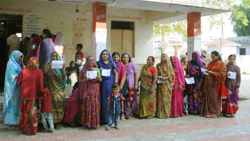 Voters waiting at a polling booth in India. Photo: PIB