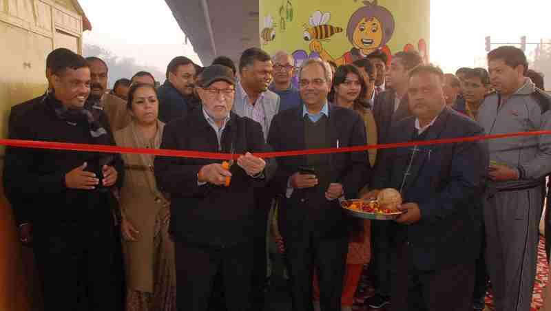 Delhi LG Anil Baijal cutting a ribbon