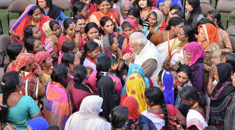 Narendra Modi interacting with the beneficiaries of the Pradhan Mantri Ujjwala Yojana, in New Delhi on February 13, 2018