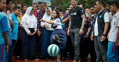 UNICEF Goodwill Ambassador David Beckham plays football with students and teachers at the SMPN 17 school in Semarang, Indonesia, March 27, 2018