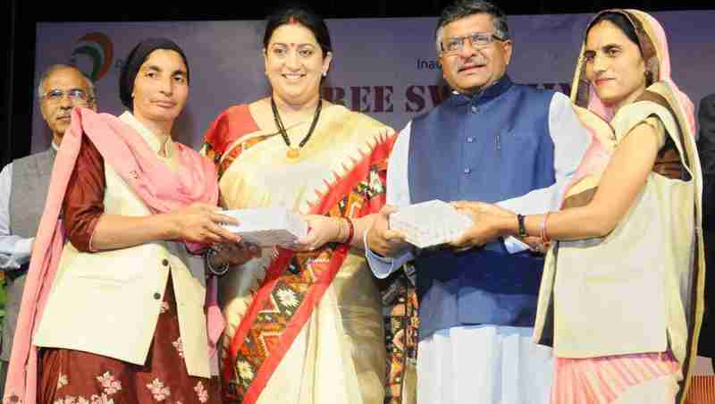 """Ravi Shankar Prasad and Smriti Irani at the inauguration of the workshop on """"Stree Swabhiman: CSC Initiative for promoting Women's Health & Hygiene"""", on the International Women's Day, in New Delhi on March 08, 2018"""