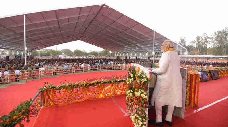 Narendra Modi addressing a public meeting, in Varanasi, Uttar Pradesh on March 12, 2018 (file photo). Courtesy: PIB