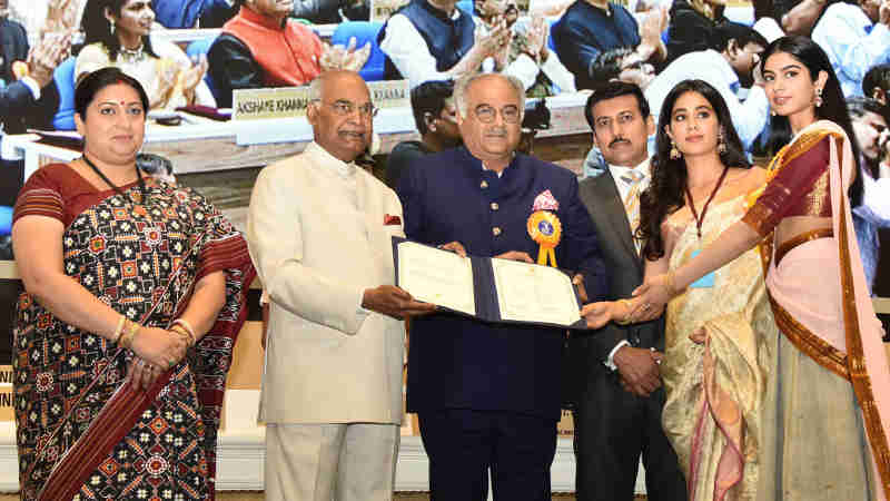 Ram Nath Kovind presenting the Best Actress Award to Sridevi (posthumous). The award was received by her husband Boney Kapoor and daughters Janhvi Kapoor and Khushi Kapoor, at the 65th National Film Awards Function, in New Delhi on May 03, 2018.
