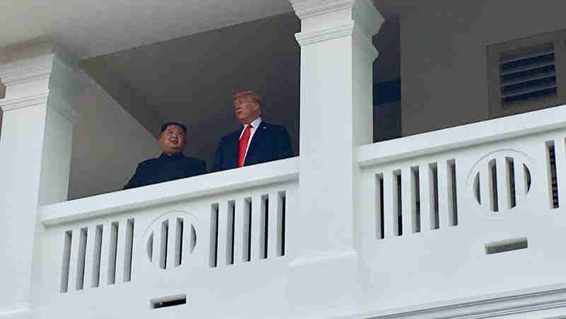 President Trump and North Korean Leader Kim Jong Un on a balcony after finishing their meeting (file photo). Courtesy: White House