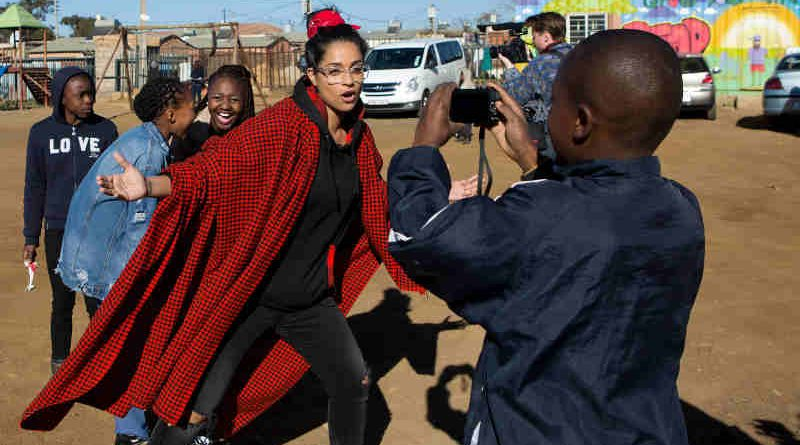 On 22 July 2018 in South Africa, (centre) UNICEF Goodwill Ambassador Lilly Singh interacts with a child during a visit to the Isibindi Safe Park in Soweto. Photo: UNICEF
