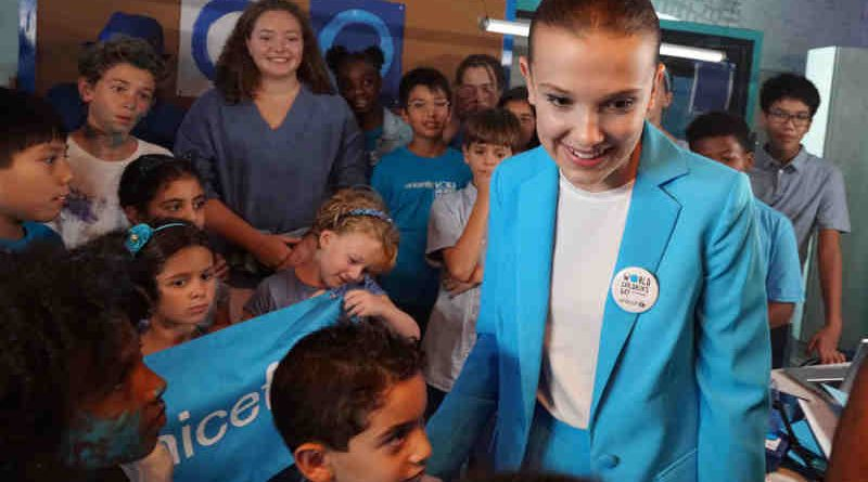 UNICEF supporter Millie Bobby Brown on the set of a video produced for World Children's Day 2018 on 24 August 2018 in New York City in the United States of America. Actor Millie Bobby Brown has teamed up with UNICEF Goodwill Ambassadors Orlando Bloom, Liam Neeson and Lilly Singh; singer-songwriter Dua Lipa and performance artists the Blue Man Group, in a new video released by UNICEF ahead of World Children's Day, celebrated on 20 November 2018. The short video shows the 14 year-old star – who has symbolically changed her name to Millie Bobby 'Blue' to mark the occasion – overseeing a global 'go blue' operation. Alongside her team of young helpers, Millie calls on fellow UNICEF Goodwill Ambassadors and supporters to join her in going blue – by wearing or displaying the colour blue – in support of children's rights. As the story unfolds, viewers see the stars responding to Millie's call while going about their daily lives. Liam Neeson bakes blue cupcakes while reenacting a famous scene from his cult-hit Taken, Dua is in studio re-recording the lyrics of her global hit Be The One from red to blue, Orlando is on a film set working under his new name – Orlando 'Bluem' – and Lilly is at home making 'blunicorn' smoothies. UNICEF's annual World Children's Day is commemorated each year on 20 November and marks the anniversary of the adoption of the Convention on the Rights of the Child. The global day raises awareness and vital funds for the millions of children who are unschooled, unprotected and uprooted. This year, UNICEF is inviting the public to go online and sign its global petition asking for leaders to commit to fulfilling the rights of every child now and for future generations, and to Go Blue for every child by doing or wearing something blue on 20 November.