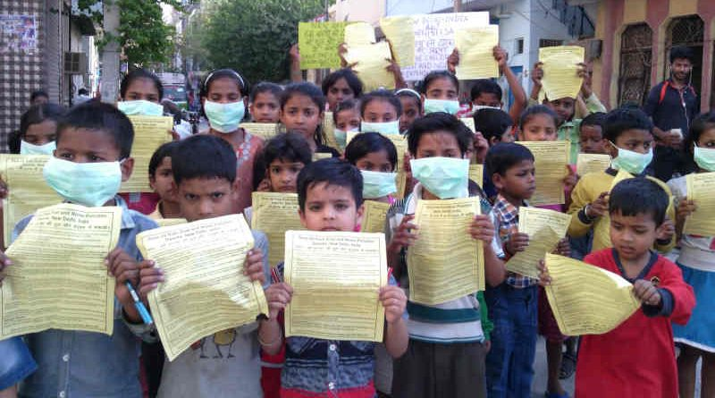 Children of RMN Foundation free schools distributing pamphlets during an environment protection campaign, urging the Delhi government to save them from pollution. But the careless government is not taking any steps to stop pollution. Campaign and photo by Rakesh Raman, founder of the humanitarian organization RMN Foundation.