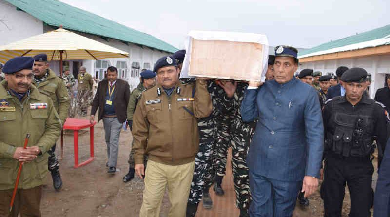 Rajnath Singh shouldering the coffin of a martyred CRPF Jawan, at the Regional Training Centre, in Srinagar on February 15, 2019. Photo: PIB