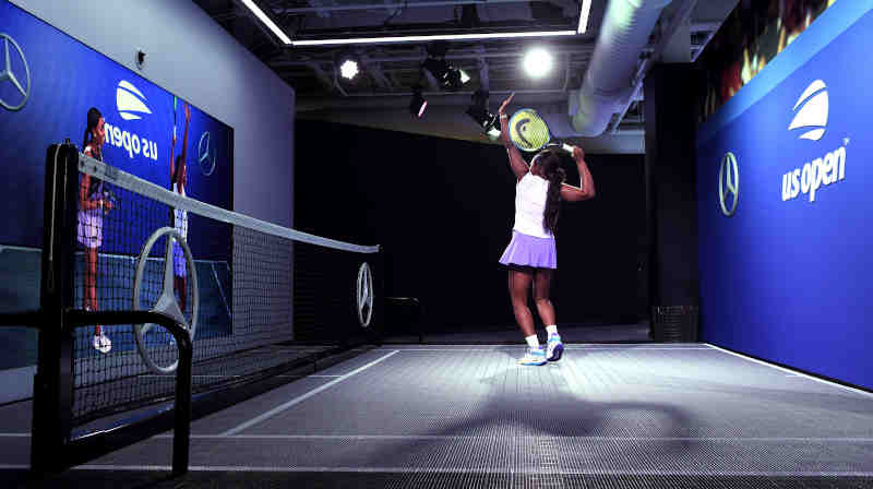 2017 US Open Champion and Mercedes-Benz Ambassador Sloane Stephens Tries the All-New Mercedes-Benz Augmented Reality Experience at the US Open Fan Zone featuring MBUX Technology.