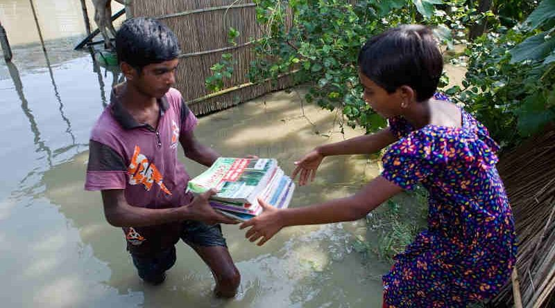 Momtaz (9) and Akobbar Hossain (15) are both residing in the village of Rajibpur, Chilmari, Kurigram which is one of the highly flood affected areas in Bangladesh. Their books got wet when water rushed into their home. Photo of 17th of July 2019. Photo: Kiron / UNICEF