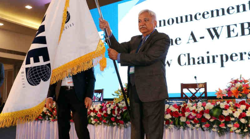 Sunil Arora with the A-WEB flag which was handed over by the outgoing Chairman of A-WEB from Romania, Ion Mincu Radulescu, at the inauguration of the 4th General Assembly meeting of A-WEB, in Bengaluru on September 3, 2019. Photo: PIB (file photo)