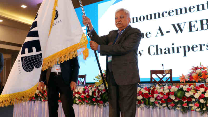 Sunil Arora with the A-WEB flag which was handed over by the outgoing Chairman of A-WEB from Romania, Ion Mincu Radulescu, at the inauguration of the 4th General Assembly meeting of A-WEB, in Bengaluru on September 3, 2019. Photo: PIB