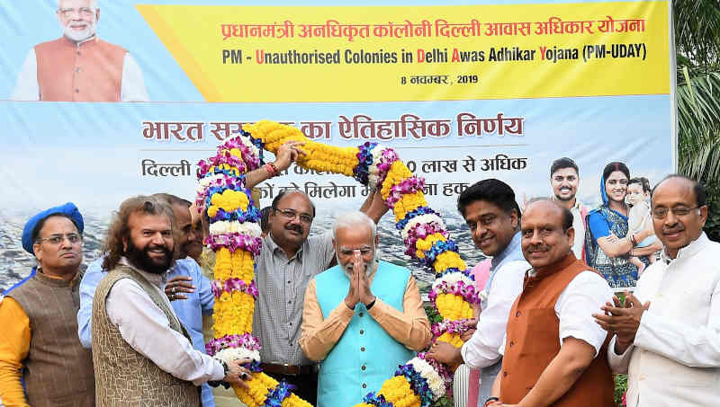 Narendra Modi being felicitated by the RWA Members for regularization of unauthorized colonies in Delhi, under the PM-UDAY (Unauthorised colonies in Delhi Awas Adhikar Yojna), in New Delhi on November 08, 2019. Photo: PIB