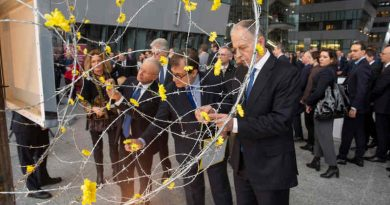 """NATO Deputy Secretary General Mircea Geoană and Francesco Talò (Italian Permanent Representative to NATO) at the unveiling of art installation """"Dandelions"""" at a ceremony hosted by the Italian delegation to NATO, marking the International Holocaust Remembrance Day. Photo: NATO"""