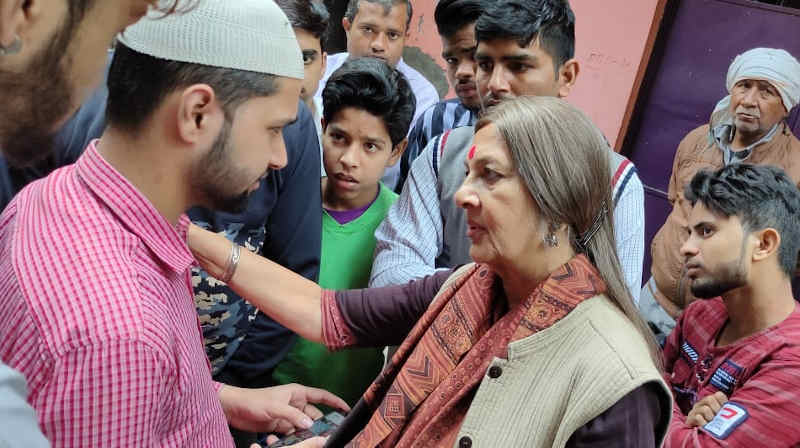 Brinda Karat meeting people affected by Delhi violence. Photo: CPI(M)