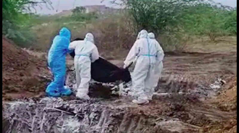 Dead bodies wrapped in a plastic cover were tossed into a pit for burial. Screengrab