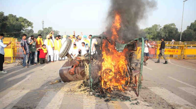 Protesters burn a tractor in New Delhi on September 28, 2020 to oppose the farm laws introduced by the Modi government. Photo: Indian Youth Congress