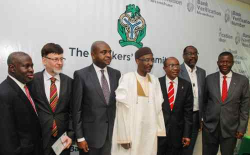 Opening ceremony of the Dermalog biometric system for Nigeria's banks - including the Governor of the Central Bank, Sanusi Lamido Sanusi (centre), and the CEO of Dermalog, Günther Mull (second from left).