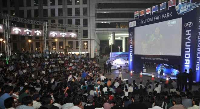 Cricket fans watching match at Hyundai Fan Park at Cyber Hub, Gurgaon