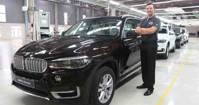 Mr. Robert Frittrang, Managing Director, BMW Plant Chennai with the all-new BMW X5 as it rolls out of BMW Plant Chennai