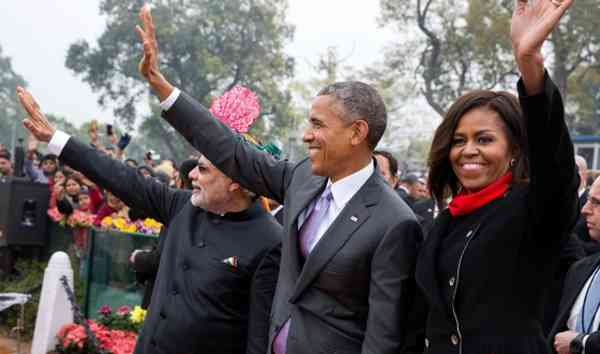 President Barack Obama and First Lady Michelle Obama wave to the crowd at the Rajpath saluting base following the Republic Day Parade in New Delhi, India. January 26, 2015. (Official White House Photo by Pete Souza)