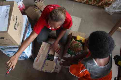 Save the Children staff in Vanuatu prepare to distribute vital aid packages that include hygiene kits, food and water. Photo: Evan Schuurman / Save the Children