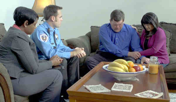 """A scene from the demonstration video embedded in the """"We Regret to Inform You..."""" online training module developed jointly by the FBI and Pennsylvania State University to provide assistance to law enforcement and other first responders charged with providing death notifications to victims' next of kin."""