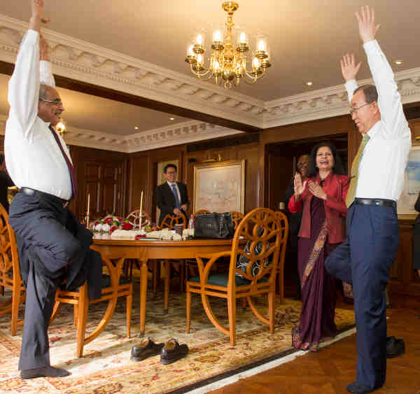 UN Secretary-General Ban Ki-moon gets a yoga lesson from Vijay Nambiar, the Secretary-General's Special Adviser on Myanmar. UN Photo / Mark Garten