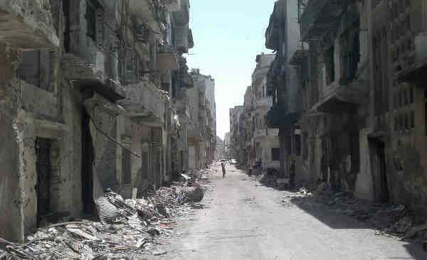A street lined with rubble and destroyed buildings in the Old City area of Homs, Syria. Photo: UNICEF / Nasar Ali