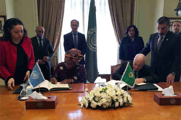 In Cairo, Special Representative on Sexual Violence in Conflict, Zainab Hawa Bangura (left), and Nabil el-Araby, Secretary-General of the League of the Arab States (right), sign agreement of cooperation. UN Photo: Manel Stambouli
