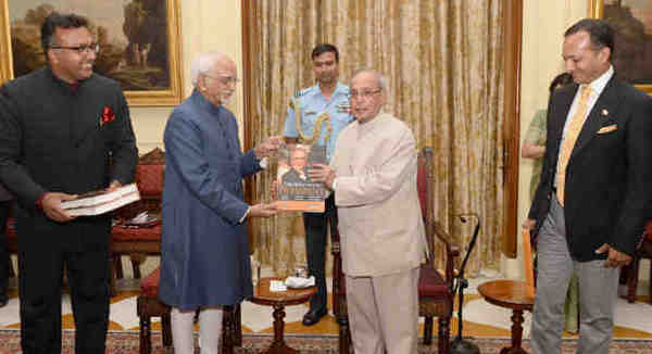 """Pranab Mukherjee receiving the first copy of the book """"The Education President"""" from the Vice President, M. Hamid Ansari, at the Rashtrapati Bhavan, in New Delhi on June 08, 2016."""